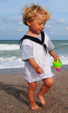 Little mariner on the beach Stock Photography