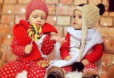 Little X-mas boys. Cute little X-mas boys with lollipop stock photos