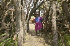 Little Masai girl at gate in village near Tsavo National Park, Kenya, Africa Royalty Free Stock Image