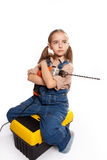 LIttle master girl with drill Stock Photography
