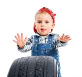 Little mechanic with a tire. Cute little mechanic with a tire. Isolated on the white backround stock photography