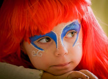 The Little Mermaid Ariel.Carnival. Girl in red hair, face painted like  Little Mermaid Ariel.Carnival Stock Photos