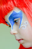 The Little Mermaid Ariel.Carnival. Girl in red hair, face painted like  Little Mermaid Ariel.Carnival Royalty Free Stock Images