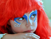 The Little Mermaid Ariel.Carnival. Girl in red hair, face painted like  Little Mermaid Ariel.Carnival Royalty Free Stock Photo