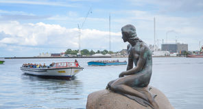 Little Mermaid bronze statue. Copenhagen, Denmark - August 25, 2014-The Little Mermaid bronze statue monument by Edvard Eriksen.This displayed on a rock by the stock image