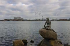 Little Mermaid Copenhagen. The Little Mermaid (Danish: Den lille havfrue) is a bronze statue by Edvard Eriksen, depicting a mermaid. The sculpture is displayed royalty free stock image