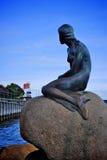 Little mermaid in copenhagen denmark. The little mermaid in copenhagen denmark with a blue sky background royalty free stock photos