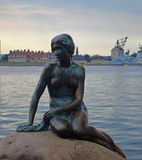 The Little Mermaid. Danish: Den lille Havfrue is a bronze statue by Edvard Eriksen, depicting a mermaid. The sculpture is displayed on a rock by the waterside stock photos