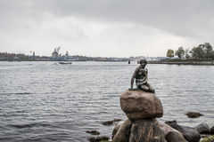 Little Mermaid. The famous bronze statue symbol of Copenhagen photographed on a cloudy day stock photo