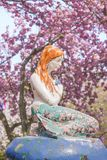 The Little Mermaid from Hans Christian Andersen`s book under the. Cherry blossoms of Asukayama Park in Kita district, north of Tokyo royalty free stock photos