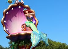 The Little Mermaid smiling brightly at Disney's Magic Kingdom Stock Image