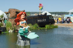 Little Mermaid and toxic Lake, Dismaland. WESTON-SUPER-MARE, UK - AUGUST 26, 2015:  The Little Mermaid mutated by chemicals at the toxic lake at Dismaland in Stock Images