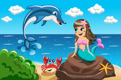 Little Mermaid watching jumping dolphin. Smiling little Mermaid sitting on the rock watching jumping dolphin Stock Photo