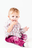 Little messy with flour boy on white background Stock Images