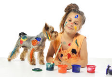 Little messy girl painter with dog