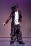 Little Micheal Jackson. A boy dances on the stage imitating Micheal Jackson stock image