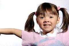 Little miss happy. A young girl poses with a happy attitude Royalty Free Stock Photos