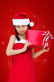 Little miss santa is happy about a gift Stock Photo