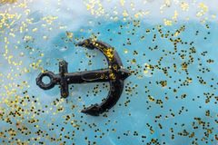 Little model anchor for decorative purposes. Tiny model anchor for decorative purposes Stock Photos