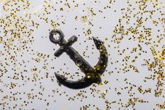 Little model anchor for decorative purposes. Tiny model anchor for decorative purposes Royalty Free Stock Photos