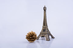 Little model Eiffel Tower  and pine cone Stock Image