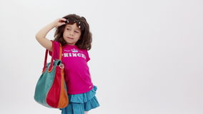 Little model. Little girl passing by like a model stock footage