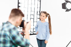 Little model poses when being photographed Royalty Free Stock Photography