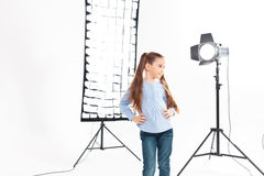 Little model poses heartily during working process Stock Photography