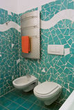 Little modern bathroom with green tiles
