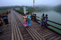 Little Mon selling on the wooden bridge. Stock Photos