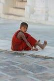 Little monk. Little playing monk at Mingun Stock Photos