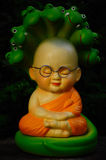 Little Monk doll with snake royalty free stock photography