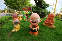 Little monk dolls in garden. They are little monk dolls in garden.this place is in east of thailand Royalty Free Stock Photography