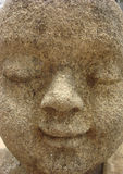 Little monk face on spiritual meditation sculpture Royalty Free Stock Photography