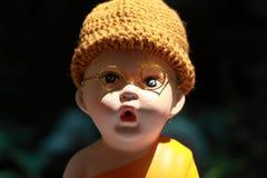 Little Monk Porcelain doll. Porcelain doll taken in my house Royalty Free Stock Photo