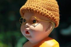 Little Monk Porcelain doll. Porcelain doll taken in my house Royalty Free Stock Photos