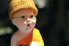Little Monk Porcelain doll stock images