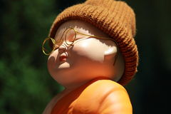 Little Monk Porcelain doll stock photo