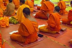 Little monk reading a book taken stock photo