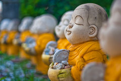 Little Monk statues. Stock Images