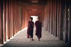 Little monks. Walking at old temple, Salay Bagan Myanmar royalty free stock photography