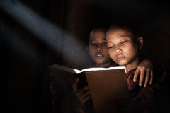 Little monks reading book. Inside monastery Royalty Free Stock Photo