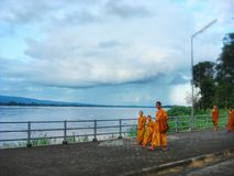 Little Monks walking along Khong river Stock Images