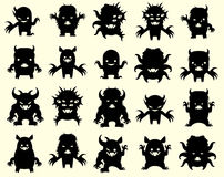 Little monsters. Set of funny monsters in black silhouette Stock Image