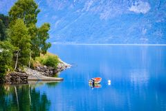 Little boat on water, norway fjord Royalty Free Stock Photography