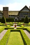 Little Moreton Hall Knot Garden. Little Moreton Hall a moated half-timbered manor house built in the 16th century Stock Image