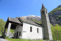 Little mountain church. Cute, little church built from stone standing amidst fresh spring green in a mountain valley in Ticino,Switzerland Stock Photos