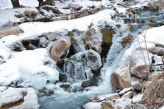 A little mountain river waterfall in the winter weather. Stock Photo