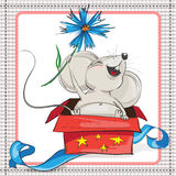 A little mouse with a flower climbs from gift box. On white background in frame royalty free illustration