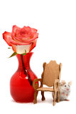 Little Mouse with Red Rose. Adorable white and tan pet mouse hiding behind a miniature chair with a red rose in a vase Royalty Free Stock Images